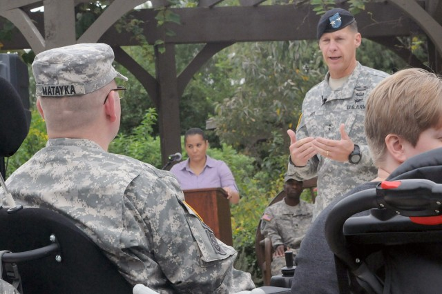 "FORT SAM HOUSTON, Texas - Maj. Gen. William Roy makes opening remarks at the Purple Heart Medal presentation ceremony Oct. 18 for Staff Sgt. Edward Matayka at the Warrior and Family Support Center. ""It gives me great honor to be here today to present to you our nation's Purple Heart (medal) in recognition of your tremendous sacrifices,"" Roy said to his former Soldier. Matayka, a combat medic, served with Company A, Special Troops Battalion, 86th Infantry Brigade Combat Team, Vermont National Guard, when he was wounded in July 2010. The brigade was commanded by (then Col.) Roy, who now serves as the deputy commanding general for U.S. Army North (Fifth Army)."