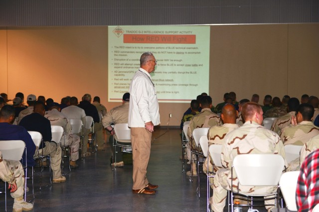 Al Guins, instructor from TRADOC Wargaming, Experimentation, Test and Evaluation Directorate, tells his audience of OPFOR Soldiers that they will need to start thinking like members of the Red Team, not the Blue Team, or U.S. Forces, and use Red Team tactics.