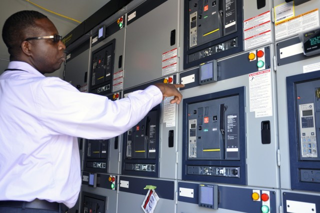 Arsenal Electrical Engineer Benjamin Dedjoe testing the electronics to the new $669,000 power substation.  Dedjoe designed and then supervised the emplacement of the substation that will dramatically improve safety and consistent power supply.
