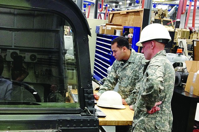 U.S. Army Ordnance School Soldiers search for information in an online manual during wheel vehicle maintenance training recently.