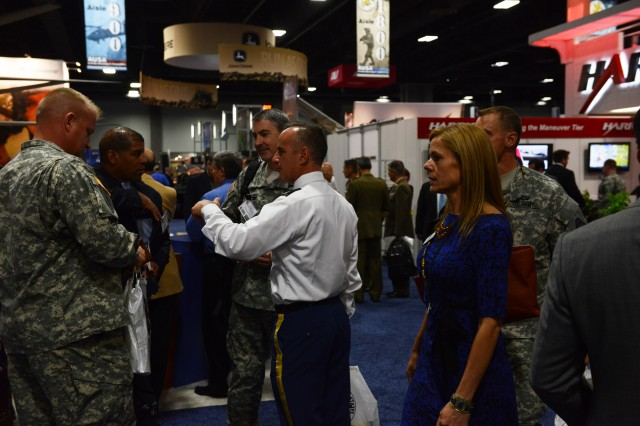 Soldiers interact with industry partners during the 2013 Association of the U.S. Army Annual Meeting and Exposition, at the Washington Convention in Washington, D.C.