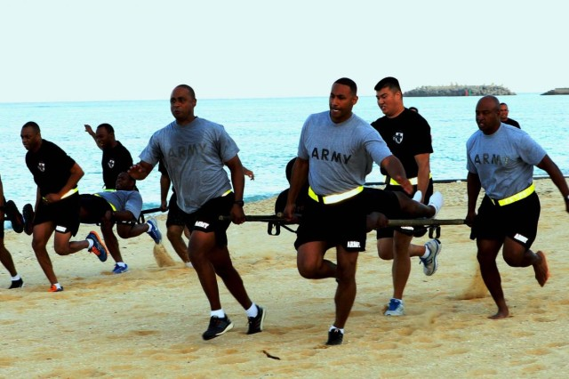 Soldiers from the 10th Regional Support Group move out to the finish line during the litter carry competition during Headquarters and Headquarters Company, 10th Regional Support Group Sports Day Oct. 18 at Torii Beach, Okinawa, Japan. The event helped to strengthen esprit de corps and unit cohesion.