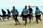 Headquarters and Headquarters Company, 10th Regional Support Group soldiers enjoy a competitive day at the beach