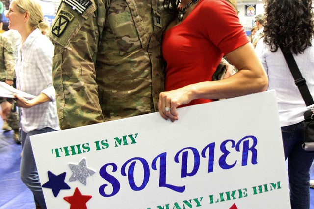Capt. Christopher Epstein, assigned to 1st Brigade Special Troops Battalion, 1st Brigade Combat Team, 10th Mountain Division (LI), is greeted by his wife Kristen at a welcome home ceremony Friday at Magrath Sports Complex on Fort Drum. Soldiers of 1st BCT returned from a nine-month deployment in Afghanistan.