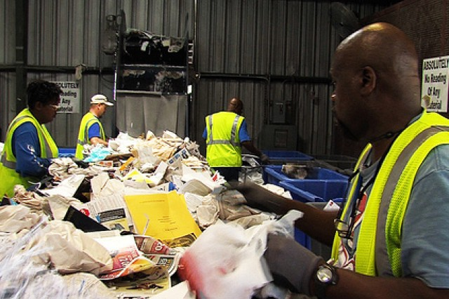 Fort Hood Recycle Center employees sort through paper to be recycled. The center also recycles plastic, metal and Styrofoam among other materials.