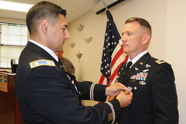 Lt. Col. Raymond Herrera, 1st Battalion, 212th Aviation Regiment commander, awards CW3 Michael Otto, E Company, 1st Battalion, 212th Aviation Regiment, the Air Medal with Valor device Oct. 18 at Lowe Army Heliport.