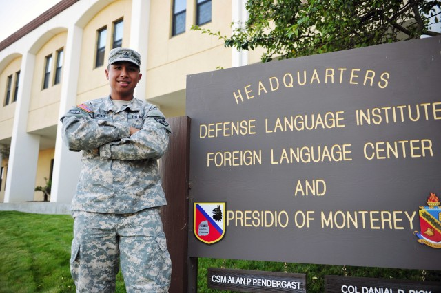 Staff Sgt. Eric J. Meas poses in front of Headquarters at the Defense Language Institute Foreign Language Center just days before receiving the prestigious Soldier's Medal, an award given to awarded to a U.S. service member or of a friendly foreign nation who, while serving in any capacity with the U.S. Army, distinguished himself or herself by heroism not involving actual conflict with an enemy.