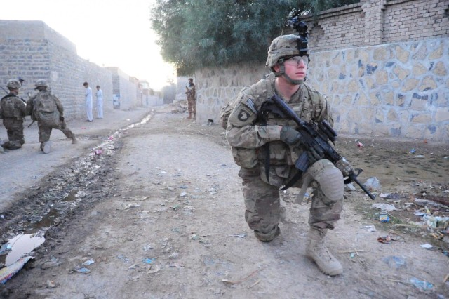 Spc. Mackenzie Venable, a combat medic with 1st Platoon, Easy Company, 2nd Battalion, 506th Infantry Regiment, 4th Brigade Combat Team, 101st Airborne Division (Air Assault), pulls security during a partnered patrol in Madi Khel, Khowst Province, Afghanistan, Oct. 20, 2013. The Soldiers conducted a partnered operation with the newly formed Khowst Provincial Response Company. The operation was used to validate the training that the Khwost PRC recently received and ensure that illegal weapons were not being stored in historical weapons cahce points.