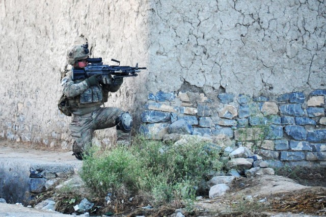 Pfc. James Rightley an infantryman with 1st Platoon, Easy Company, 2nd Battalion, 506th Infantry Regiment, 4th Brigade Combat Team, 101st Airborne Division (Air Assault), pulls security around a corner during a partnered patrol in Madi Khel, Khowst Province, Afghanistan, Oct. 20, 2013. Easy Company Soldiers conducted a partnered operation with the newly formed Khowst Provincial Response Company. The operation was used to validate the training that the Khwost PRC recently received and ensure that illegal weapons were not being stored in historical weapons cahce points.