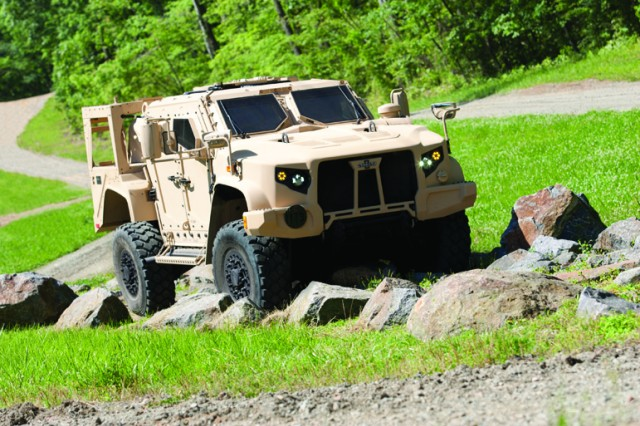 Oshkosh Defense's Joint Light Tactical Vehicle prototype negotiates the off-road demonstration course at the Transportation Demonstration Support Area, in Quantico, Va.