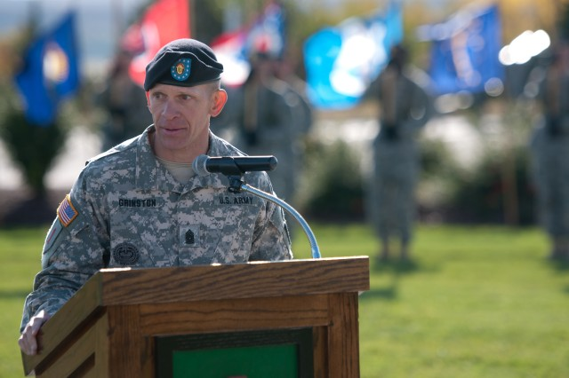 "Command Sgt. Maj. Michael A. Grinston, 1st Inf. Div. senior noncommissioned officer, thanks his wife and children for their contribution to his career during a ceremony Oct. 25 at Fort Riley's Victory Park. Grinston was officially welcomed to the ""Big Red One"" and Fort Riley during the Victory Honors ceremony. He last served as the senior noncommissioned officer of the 4th BCT, 101st Airborne Div."