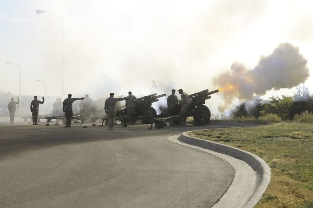 Soldiers from the 1st Bn., 5th FA Regt., 1st ABCT, 1st Inf. Div., fire cannons Oct. 25 during the playing of the national anthem at the Victory Honors Ceremony for Command Sgt. Maj. Charles V. Sasser Jr. and Command Sgt. Maj. Michael A. Grinston in Victory Park on Fort Riley. The ceremony saw Sasser, who has been the division's highest-ranking noncommissioned officer for almost two years, transition responsibility of the division to Grinston.