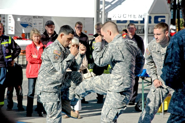 Sgt. Jose Orta and Pfc. David Marcet showcase mixed martial arts techniques during the reservist day event.