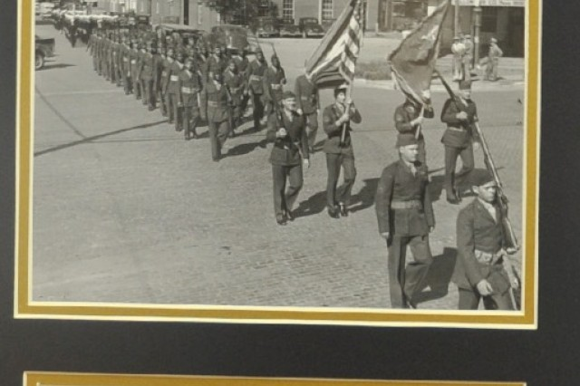 A regiment of African-American Marines march in downtown McAlester, Okla., during the Navy Day Parade, 1945.