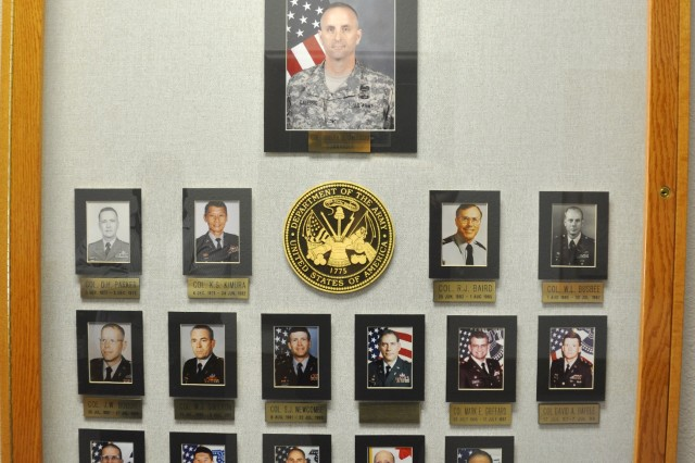 Historical display of past and current McAlester Army Ammunition Plant commanders.