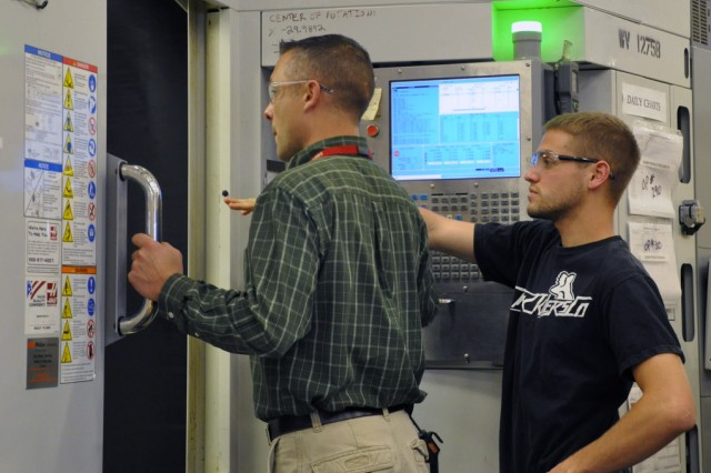 This is some of the behind the scenes beauty at the arsenal as supervisor John Zayhowski, left, mentors first-year machinist Dylan Kusaywa. Dylan graduated from the arsenal's four-year apprentice program last August and today, he is working on prototype production.