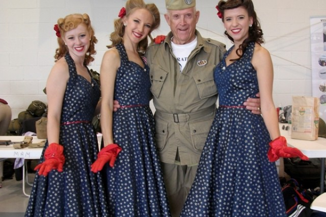 Retired Sgt. Maj. Dayton Herrington poses with three World War II USO Showgirl re-enactors at the Warbirds Over the Beach Air Show at the Military Aviation Museum in Virginia Beach, May 2012.