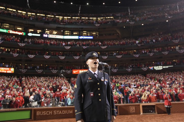 """Sgt. Christine Permenter, member of the 399th Army Band, sings """"God Bless America"""" during the 7th inning stretch at Game 4 of the 2013 World Series, Oct. 27, 2013."""