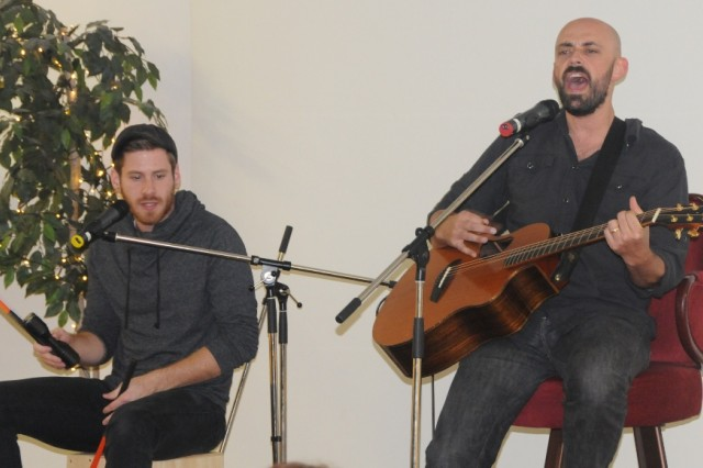 From right: American Idol finalist Phil Stacey and Trevor Hager share some songs at Hohenfels' Club Beyond as part of Anti-Bullying Month, recently.