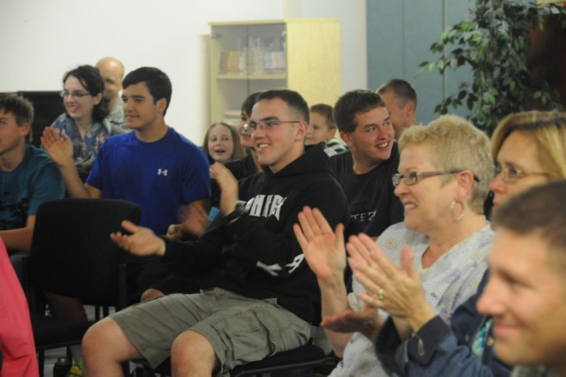 Hohenfels Community members clap and sing along to songs by American Idol finalist Phil Stacey at Club Beyond, recently.
