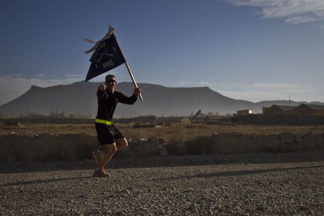 "PAKTYA PROVINCE, Afghanistan "" Carrying the guidon, U.S. Army Spc. Joshua J. Haushalter, an infantryman with 1st Battalion, 506th Infantry Regiment, 4th Brigade Combat Team, 101st Airborne Division (Air Assault), begins his last lap with a smile, while participating in a Run for the Fallen, Oct. 26, 2013. (U.S. Army photo by Sgt. Justin A. Moeller, 4th Brigade Combat Team Public Affairs)"
