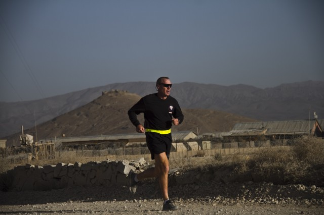 "PAKTYA PROVINCE, Afghanistan "" A U.S. Army Soldier with 1st Battalion, 506th Infantry Regiment, 4th Brigade Combat Team, 101st Airborne Division (Air Assault), begins his last lap while participating in a Run for the Fallen, Oct. 26, 2013. (U.S. Army photo by Sgt. Justin A. Moeller, 4th Brigade Combat Team Public Affairs)"