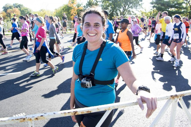 Rachel Larue, Pentagram staff photographer, poses for a photograph after finishing the 29th Army Ten-Miler Race Oct. 20, 2013.