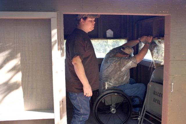 Paralyzed Veterans of America (PVA) member Tommy and his son Max get ready to hunt from a wheelchair accessible hunting blind at Russell Lake.