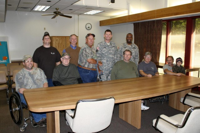 Pictured left to right: PVA members Tommy and his son Max; Ollie Lankford; Keith Crowe, Russell Project Manager; Kurt Glass, assistant sports director for Southeastern PVA chapter; Brig. Gen. Donald E. Jackson, South Atlantic Division commander; Command Sgt. Maj. Antonio Jones; and PVA members Paul, Norm, and Ricky (with his grandson Landon).