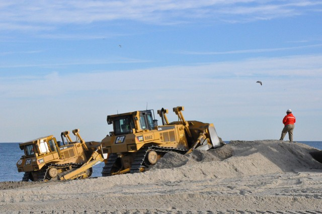 Sand being placed at Monmouth Beach, New Jersey, part of the beach renourishment project for coastal storm risk reduction that the U.S. Army Corps of Engineers is managing in partnership with the state of New Jersey. (Photo by New York District, public affairs)