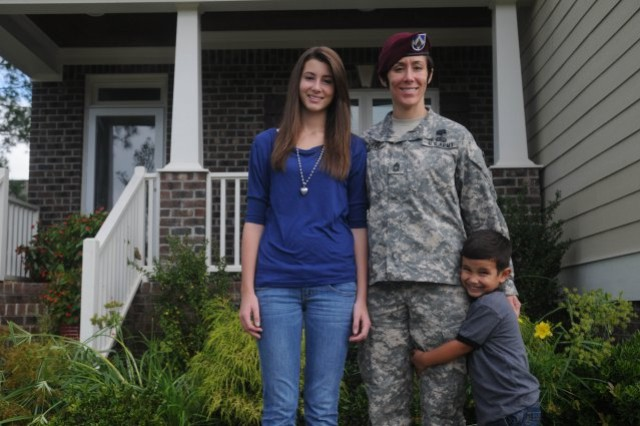 Master Sgt. Jennifer Loredo is seen with her children Alexis and Eddie, outside their home, when she was stationed at Fort Bragg, N.C.