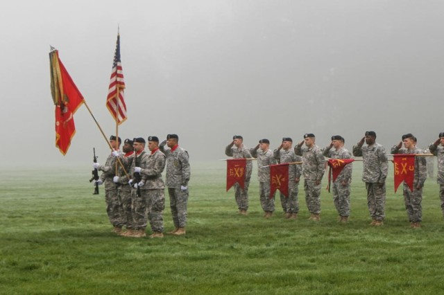 Soldiers with 1st Battalion, 377th Field Artillery Regiment, 17th Fires Brigade, 7th Infantry Division, present arms while the national anthem plays during an inactivation ceremony at Watkins Field, Joint Base Lewis McChord, Oct. 23. The battalion is inactivating as part of an Army strategy designed to transfer personnel and capabilities to where they are needed most. (U.S. Army photo by Spc. Nathan Goodall, 17th Fires Bde. Public Affairs)