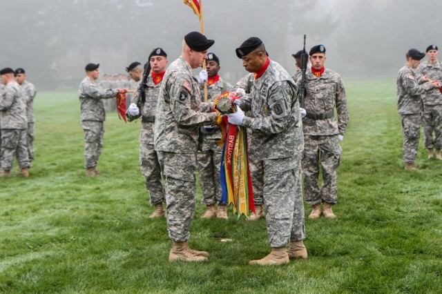 Lt. Col. Alan R. Wagner, the battalion commander for 1st Battalion, 377th Field Artillery Regiment, 17th Fires Brigade, 7th Infantry Division, prepares to case the unit colors alongside Command Sgt. Maj. Walter D. Overton, the 1-377 FA command sergeant major, during an inactivation ceremony at Watkins Field, Joint Base Lewis McChord, Oct. 23. The battalion is inactivating as part of an Army strategy designed to transfer personnel and capabilities to where they are needed most. (U.S. Army photo by Spc. Nathan Goodall, 17th Fires Bde. Public Affairs)