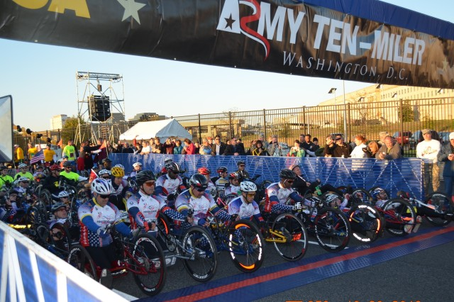 The Army Ten-Miler starting line with the 85 athletes who competed in the Wounded Warrior and Wheelchair category.  The count consisted of  35,000 registered race participants and thousands of spectators during the 29th Annual Army Ten-Miler, at the Pentagon, Oct. 20, 2013.