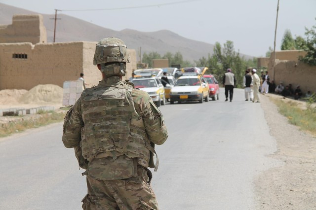 Sgt. James Brooks, a Las Vegas native and a maintenance service team non-commissioned officer-in-charge, with Company D, 703rd Brigade Support Battalion, 4th Infantry Brigade Combat Team, 3rd Infantry Division, attached to the 6th Squadron, 8th Cavalry Regiment, 4th IBCT, maintains security while his platoon conducts a hasty road repair, Sept. 2, 2013, in Logar Province, Afghanistan. The Soldiers of 6-8 Cav. were committed to the development and security of Afghanistan during their nine-month deployment in eastern Afghanistan.