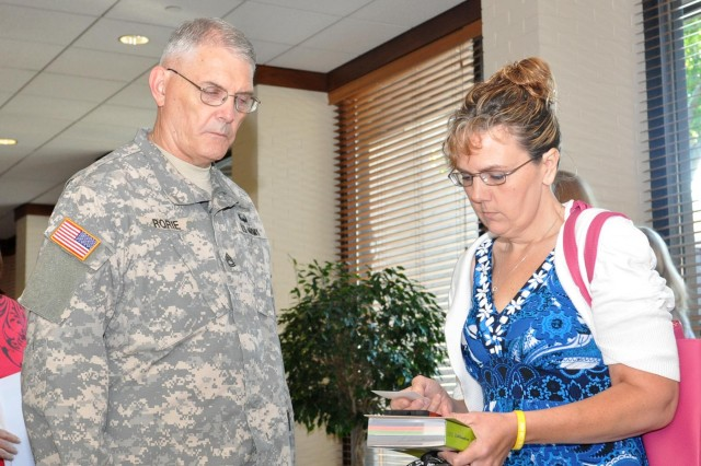 Sgt. 1st Class Michael D. Rorie talks to an attendee of the 372nd Engineer Company Yellow Ribbon Reintegration event in Brookfield, Wis.