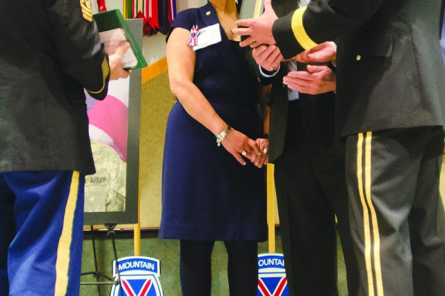 Maj. Gen. Stephen J. Townsend, right, Fort Drum and 10th Mountain Division (LI) commander, presents the Silver Star Medal on Thursday to Robert and Linda Ollis, parents of fallen hero Staff Sgt. Michael H. Ollis, while 10th Mountain Division Command Sgt. Maj. Rick Merritt looks on.
