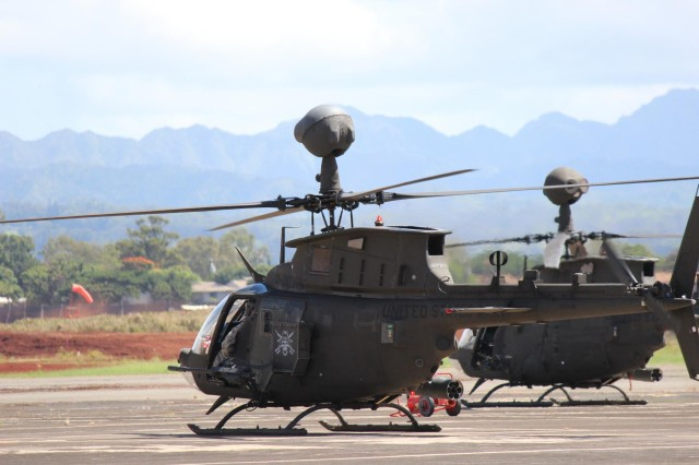 OH-58D Kiowa Warriors from 2nd Squadron, 6th Cavalry Regiment, 25th Combat Aviation Brigade, 25th Infantry Division, prepare to take off from Wheeler Army Airfield, Hawaii, as the Aviation Response Force during a Contingency Response Force validation exercise Oct. 21.