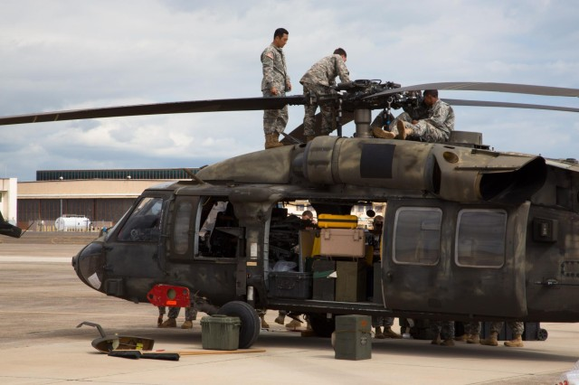 Soldiers from 2nd Battalion, 25th Aviation Regiment, 25th Combat Aviation Brigade, 25th Infantry Division, prep a UH-60 Black Hawk to be loaded onto a C-17 Globemaster III during a Contingency Response Force validation exercise Oct. 21. (Photo by Chief Warrant Officer 3 Mark Leung, 2nd Squadron, 6th Cavalry Regiment)