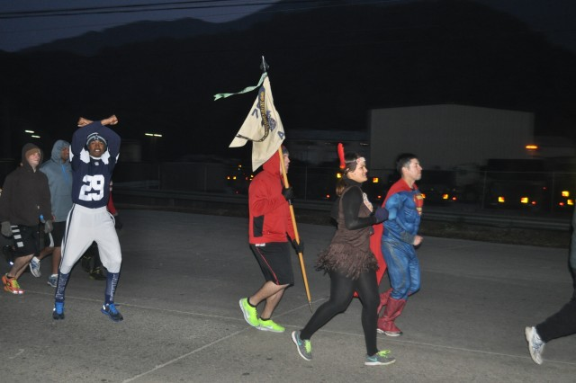 Soldiers from Company A, 70th Brigade Support Battalion, 210th Fires Brigade, 2nd Infantry Division, participate in a battalion run Oct. 31, 2013 on Camp Casey, South Korea. This run is to celebrate Halloween, and to build unit cohesion and morale throughout the unit.