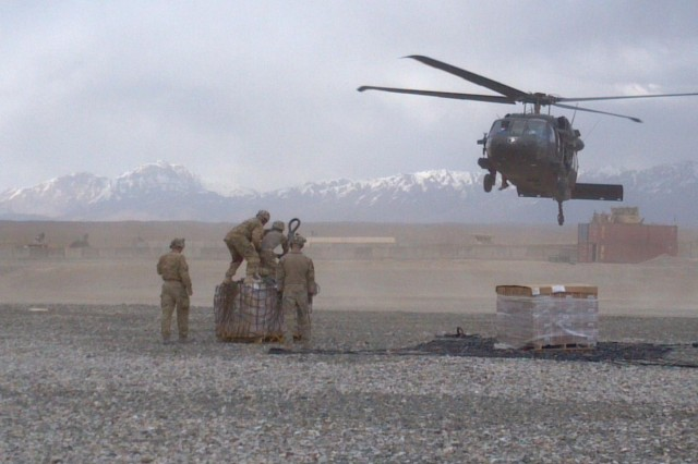 U.S. Army soldiers from Headquarters Support Company, 3rd Battalion, 7th Infantry Regiment, 4th Infantry Brigade Combat Team, 3rd Infantry Division, prepare to sling load supplies to a UH-60 Black Hawk helicopter, June 15, 2013, on Forward Operating Base Shank, Afghanistan. Resupply missions played an important role in supporting combat operations during the unit's tour in eastern Afghanistan. (Courtesy Photo)