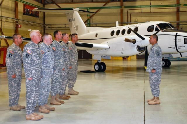 Soldiers assigned to the New York Army National Guard's Detachment 20, Operation Support Airlift Agency, stand in formation Oct. 25, 2013, during their deployment ceremony.