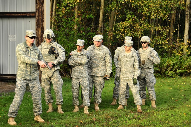 Sgt. 1st Class Stephen Cunningham, a platoon sergeant with 725th Explosive Ordnance Disposal Company, conducts a class for Soldiers who had never shot the 9 mm pistol before. Each Soldier was given a magazine of five rounds to shoot three silhouette targets 25 meters away.