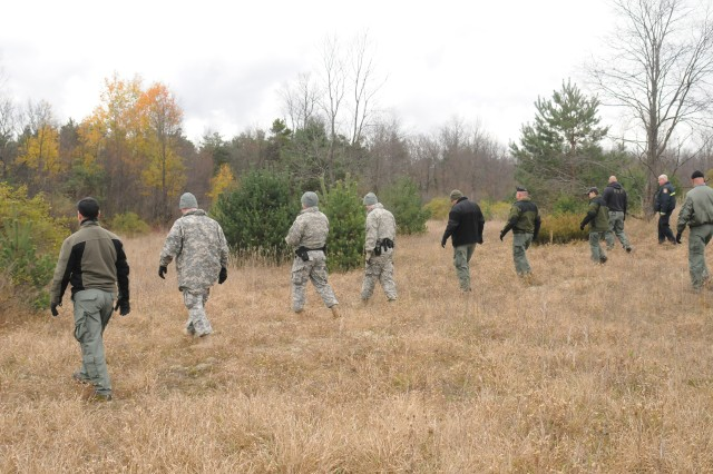 Military police Soldiers, game wardens and members of the DES Special Reaction Team, practice search techniques during a training exercise last week. Fort Drum law enforcement personnel are not only trained to uphold rules and regulations, they are trained to respond to emergency situations. Because of the cold climate, they must be trained to search for recreationists who may get lost on ranges and in training areas.