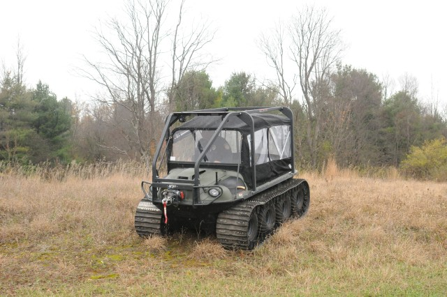 Patrolman Brian A. Wetmore, game warden, drives an Argo vehicle through the brush during a training exercise Oct. 24 on Fort Drum Range 6A.