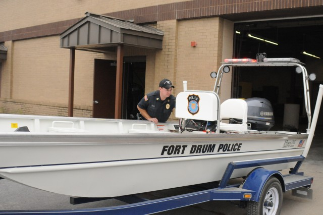DES Sgt. 1st Class David J. Drew, Game Warden Section supervisor, inspects and tests a rescue boat before covering it for storage.
