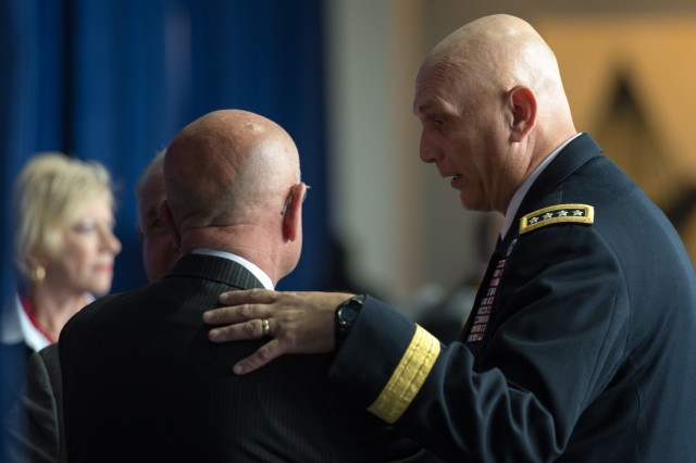 Chief of Staff of the U.S. Army, Gen. Raymond T. Odierno speaks to retired Gen. Gordon R. Sullivan, President of the Association of the United States Army (AUSA) at the Walter E. Washington Convention Center, Washington, D.C., on October 22, 2013. (U.S. Army Photo by Sgt. Mikki L. Sprenkle/Released)