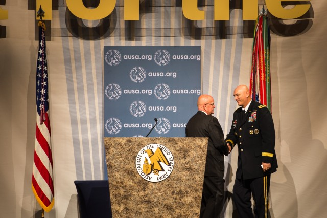 Chief of Staff of the U.S. Army, Gen. Raymond T. Odierno is greeted by retired Gen. Gordon R. Sullivan, President of the Association of the United States Army (AUSA) at the Walter E. Washington Convention Center, Washington, D.C., on October 22, 2013. Gen. Odierno was the keynote speaker at the 2013 AUSA Eisenhower Luncheon.  (U.S. Army Photo by Sgt. Mikki L. Sprenkle/Released)