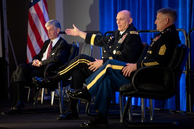 Secretary of the Army, The Honorable John McHugh, Army Chief of Staff, Gen. Raymond T. Odierno and Sergeant Major of the Army, Raymond F. Chandler III. Talk to an audience and video telecommunication during The Association of The United States Army (AUSA) Exposition at the Walter E. Washington Convention Center, Washington, D.C. on October 21, 2013.(U.S. Army photo by Sgt. Mikki L. Sprenkle/ Released)