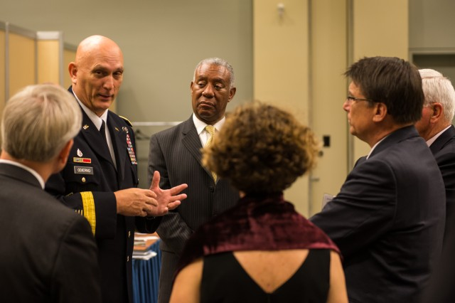 Army Chief of Staff Gen. Raymond T. Odierno speaks with the Governor of North Carolina Hon. Pat McCrory and his advisors at The Association of The United States Army (AUSA) Exposition at Walter E. Washington Convention Center, Washington, D.C. on October 21, 2013. (U.S. Army photo by Sgt. Mikki L. Sprenkle/ Released)